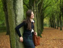 Happy woman standing outdoors and relaxing on a autumn day Royalty Free Stock Photography