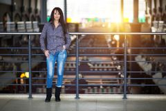 Happy woman standing in a shopping mall. Full length Royalty Free Stock Photography