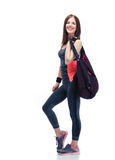 Happy woman standing with sports bag Stock Photos