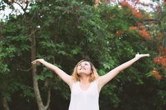Happy woman standing stretch her arms in the air. Enjoy fresh ai. R Royalty Free Stock Images