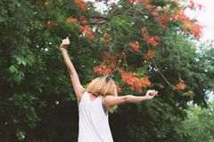 Happy woman standing stretch her arms in the air. Enjoy fresh ai. R Royalty Free Stock Photography
