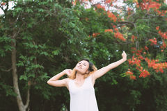 Happy woman standing stretch her arms in the air. Enjoy fresh ai. R Stock Image