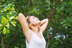 Happy woman standing stretch her arms in the air. Enjoy fresh ai. R background Royalty Free Stock Images