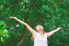 Happy woman standing stretch her arms in the air. Enjoy fresh ai. R background Stock Photo