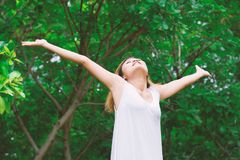 Happy woman standing stretch her arms in the air. Enjoy fresh ai. R Stock Images