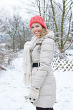 Happy woman standing in winter in snow Royalty Free Stock Photo