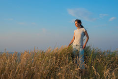 Happy woman stands in the prairie Royalty Free Stock Image