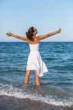 Happy woman stays in a sea water. Stock Photos