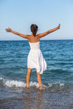 Happy woman stays in a sea water. Stock Image