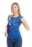 Happy woman with stethoscope gesturing thumbs up Royalty Free Stock Photo