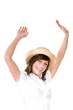 Happy woman with straw hat. Happy young woman in straw hat waving hands in air, isolated on white background Royalty Free Stock Images