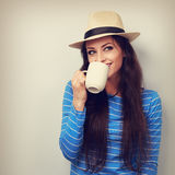 Happy woman in straw hat drinking coffee with thinking face look Stock Photography
