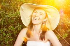 Happy woman with straw hat in summer Royalty Free Stock Photo