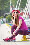 Happy woman with straw hat and sunglasses in port with yacht in background Stock Photos