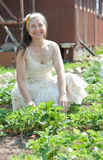 Happy  woman in strawberry plant Royalty Free Stock Photography
