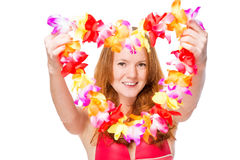 Happy woman stretches floral lei for a holiday Royalty Free Stock Photos