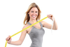 Happy Woman Stretching A Measure Tape Royalty Free Stock Photography