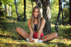 Happy woman stretching on grass Royalty Free Stock Photo