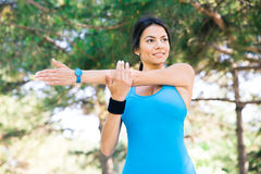 Happy woman stretching hands outdoors Royalty Free Stock Image