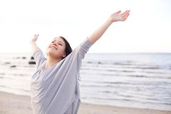 Happy Woman Stretching Her Arms to Enjoy Nature Stock Photography
