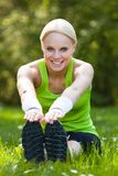 Happy Woman Stretching In Park Royalty Free Stock Images