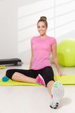 Happy woman stretching after workout stock images
