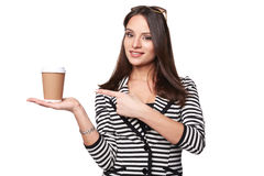 Happy Woman in Stripe Jacket Points Out to the Cup Royalty Free Stock Photos
