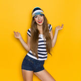 Happy Woman In Striped Shirt And Sun Visor Stock Photo