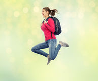 Happy woman or student with backpack jumping Royalty Free Stock Photography