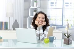 Happy woman in study Stock Image