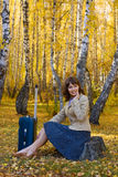Happy woman with suitcase. Stock Photo