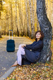 Happy woman with suitcase. Royalty Free Stock Image