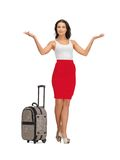 Happy woman with suitcase greeting Royalty Free Stock Photography