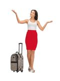 Happy woman with suitcase greeting Stock Images
