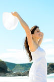 Happy woman on summer beach in Spain stock photography