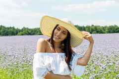 Happy woman in summer field. Young girl relax outdoors. Freedom concept. Happy woman in summer field. Young girl relax outdoors. Freedom concept Royalty Free Stock Photography