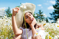 Happy woman in summer field. Young girl relax outdoors. Freedom concept. Stock Images