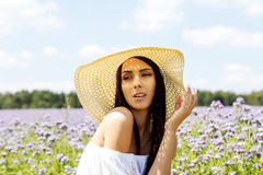 Happy woman in summer field. Young girl relax outdoors. Freedom concept. Happy woman in summer field. Young girl relax outdoors. Freedom concept Stock Image