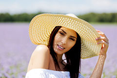 Happy woman in summer field. Young girl relax outdoors. Freedom concept. Royalty Free Stock Photography