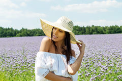 Happy woman in summer field. Young girl relax outdoors. Freedom concept. Stock Photo