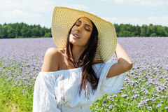 Happy woman in summer field. Young girl relax outdoors. Freedom concept. Happy woman in summer field. Young girl relax outdoors. Freedom concept Royalty Free Stock Image