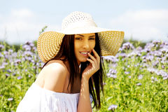 Happy woman in summer field. Young girl relax outdoors. Freedom concept. Happy woman in summer field. Young girl relax outdoors. Freedom concept Stock Photography