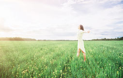 Happy woman in the summer flower meadow Stock Photo
