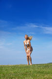 The happy woman in a summer green field Royalty Free Stock Images