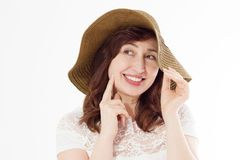 Happy woman in summer hat isolated on white background. Sun protection skin care and vacation holidays concept. Middle age female. With white healthy teeth and stock photo