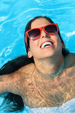 Happy woman on summer pool Royalty Free Stock Photography