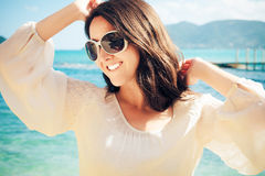 Happy woman in summer white dress on beach. Royalty Free Stock Image