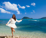 Happy woman in summer white dress on beach. Royalty Free Stock Photos
