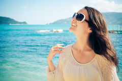 Happy woman in summer white dress on beach. Stock Photo