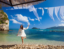 Happy woman in summer white dress on beach. Royalty Free Stock Photo